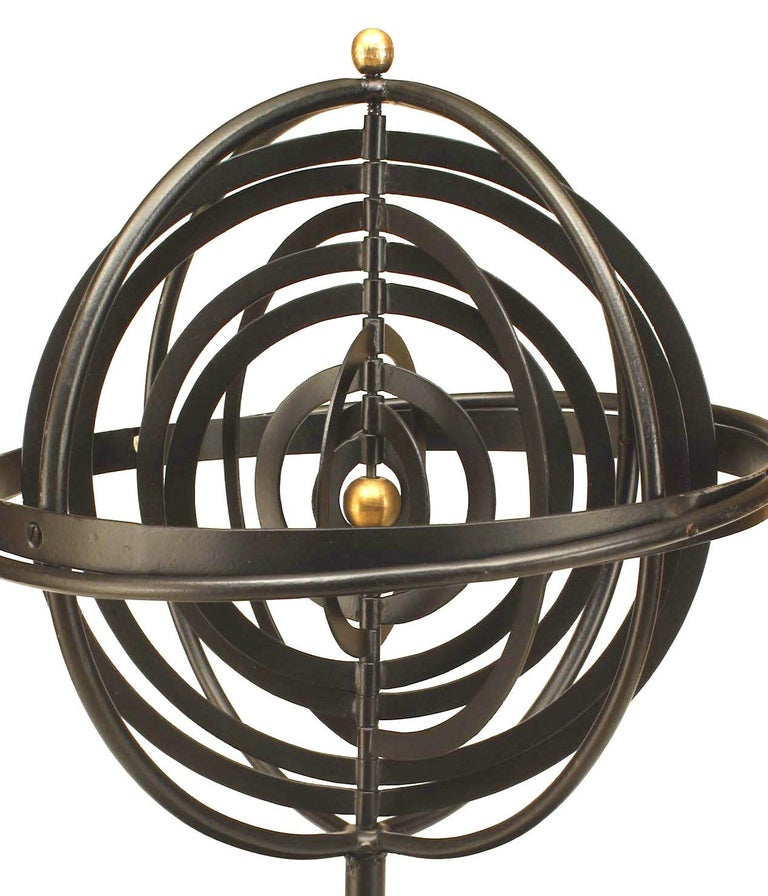 Twentieth century Renaissance style iron armillary sphere inspired by the the Copernican Model with concentric orbits, a tiered stem, and ringed circular base accented by a gold painted sun and finial.