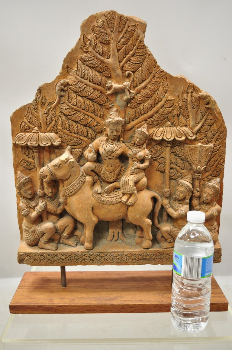 20th century Thai temple Buddhist hand carved terracotta figural sculpture statue. Item features Thai Buddhist figural carving of solid terracotta, raised on oakwood base, circa mid to late 20th century. Measurements: 20.5