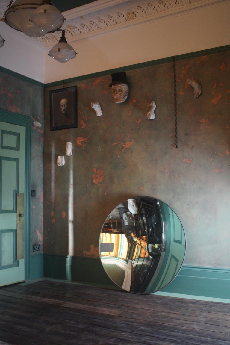 A very large concave mirror housed within its original copper bracing and lead back.  The mirror is first quarter of the 20th of century in age.  The mirror plate is in great condition, some minor wear nothing you wouldn't expect for age, some