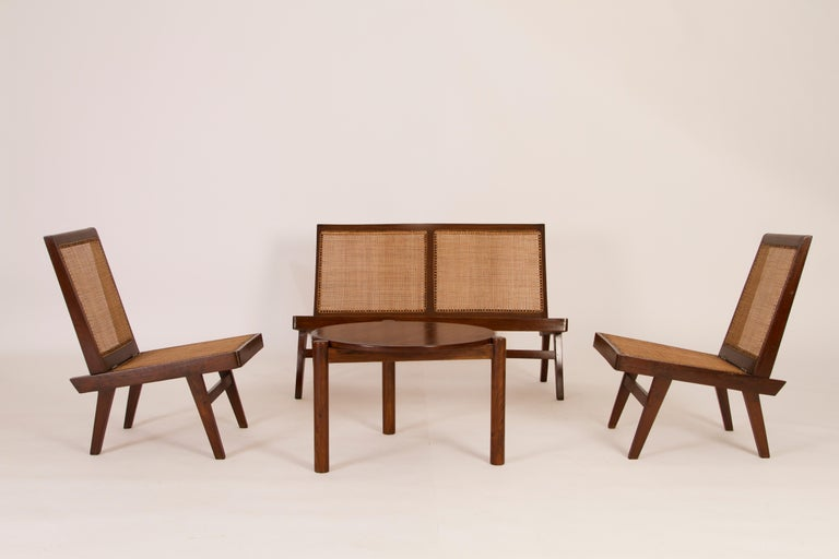 Pierre Jeanneret three-piece folding cane sofa and chairs, teak and cane Provenance: Private Residences, Chandigarth. India.