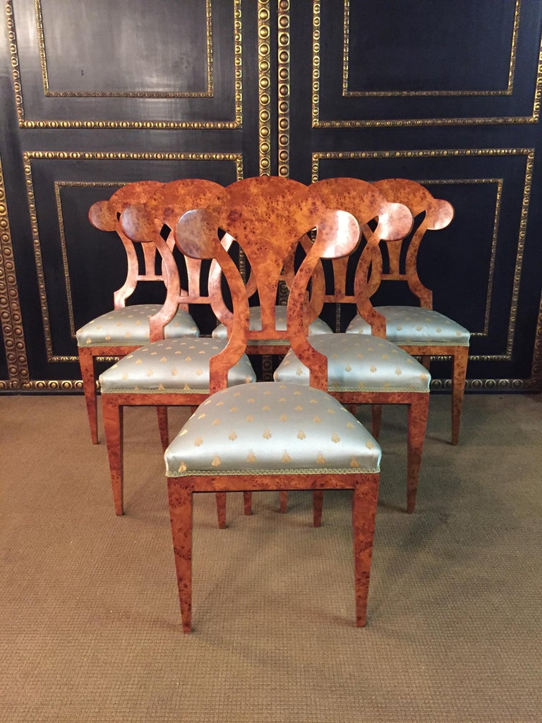 Solid beechwood with maple root veneer. Seat classical upholstered. Beautiful shape with a fantastic veneer picture, bird's eye maple. High quality fabric. Very rare as a set of six chairs.