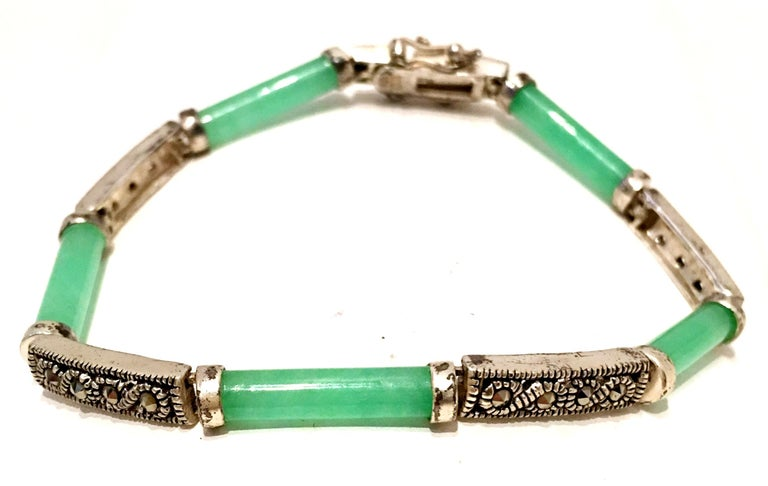 20th Century Chinese 925 Sterling Silver, Jadeite And Marcasite Link Bracelet. Features, five green jadeite links and four sterling with four marcasite stones each. Each link is approximately .75