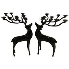 20th Century Abstract Dark Oiled Bronze Reindeer Candelabras