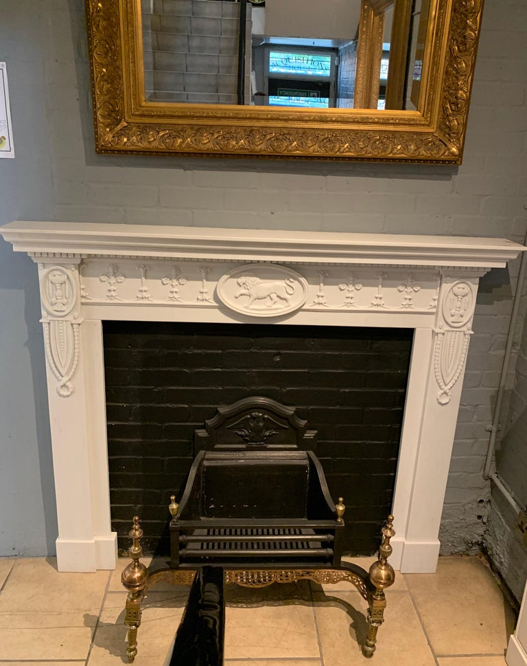 A finely hand carved English mantelpiece made from Italian statuary marble.