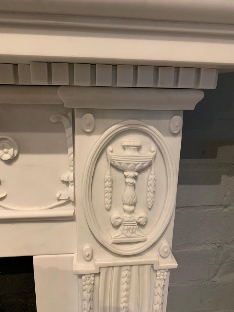 Hand-Carved 20th Century Adam Style Statuary Marble Mantelpiece For Sale