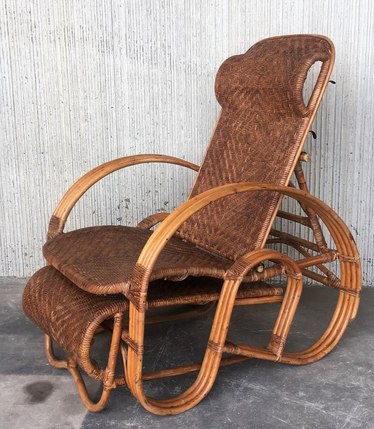 A height-adjustable chaise longue made of a bentwood frame with woven rattan. The backrest can be placed in four different positions.   The length of the chair in those positions is respectively 89in extended and 31.5 in like a