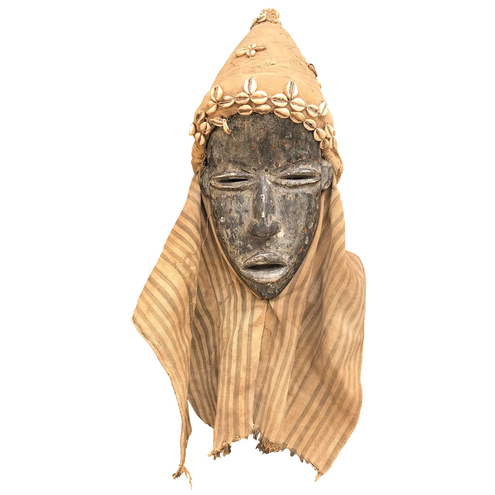 20th Century African Dan Hand Carved Mask from Liberia with Cowrie Shells