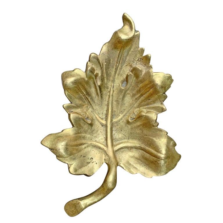 A super cool 20th century American cast bronze leaf dish with a worn finish and a beautiful patina. Perfect for change, keys, or other vices!