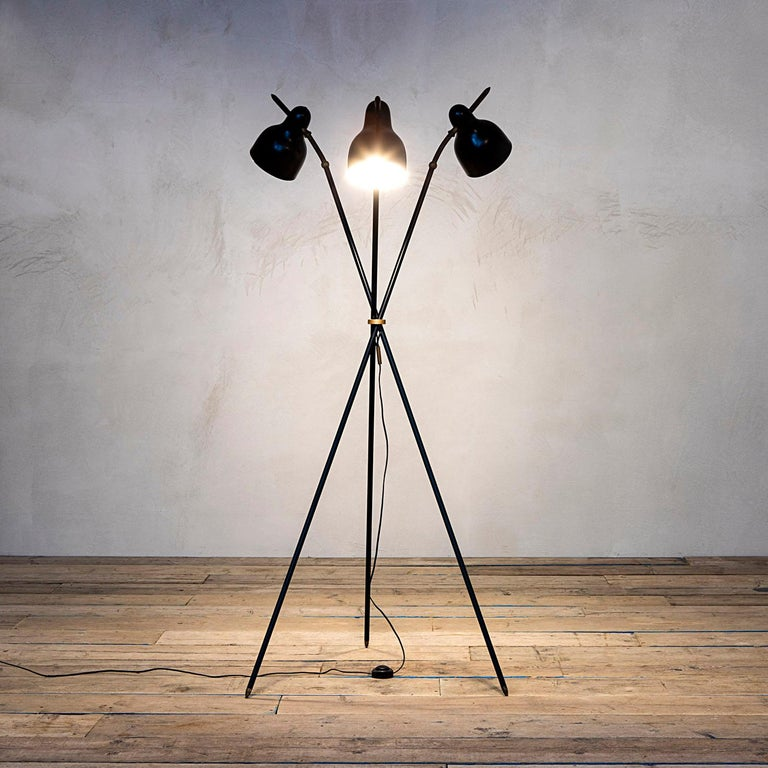 Floor lamp designed by Aneglo Lelii for Arredoluce in 1960s with three adjustable diffusers, in black brass and details in brass. Completely original, fully working, very good condition. Manufacturer label inside one of the three diffuser as in
