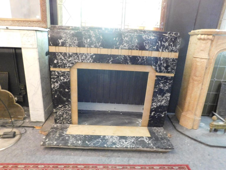 Antique Fireplace in black portoro marble and Siena yellow, Art Deco, complete with base, first half of the 20th century