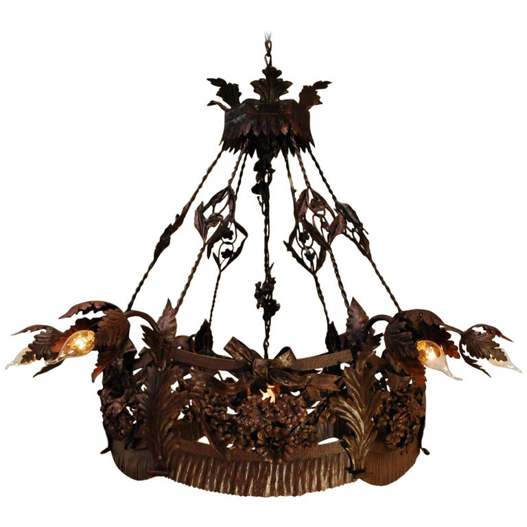 20th Century Antique French Wrought Iron Chandelier with Leafs and Flowers For Sale