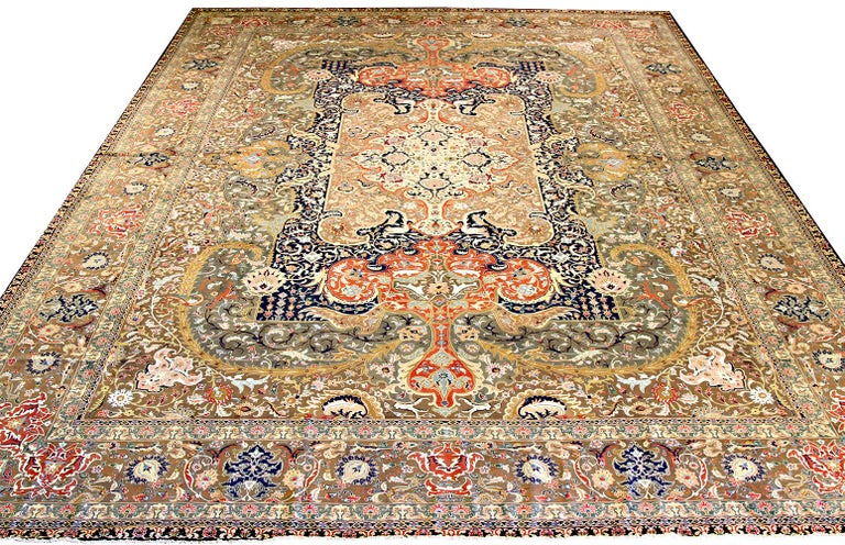 Antique Persian rug handwoven from the finest sheep's wool and colored with all-natural vegetable dyes that are safe for humans and pets. It's a traditional Tabriz weaving featuring a lovely and extraordinary ensemble of floral designs over an ivory