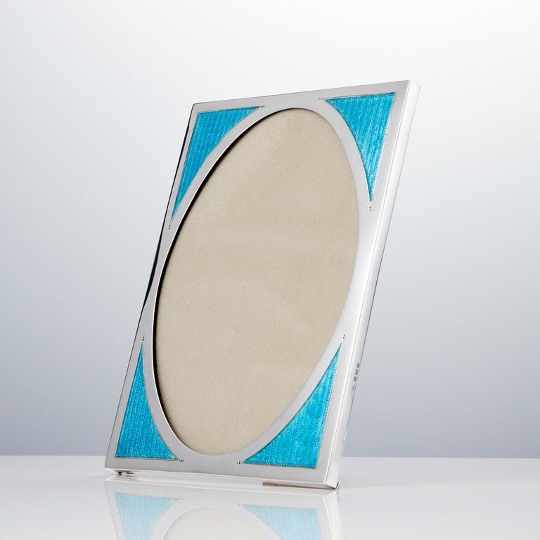 This stunning vibrant aqua marine Art Deco photo frame retains its translucent color. This piece is in excellent condition, the hall marks are in good condition, however the makers mark appears slightly vague points it to be by William Taylor. The