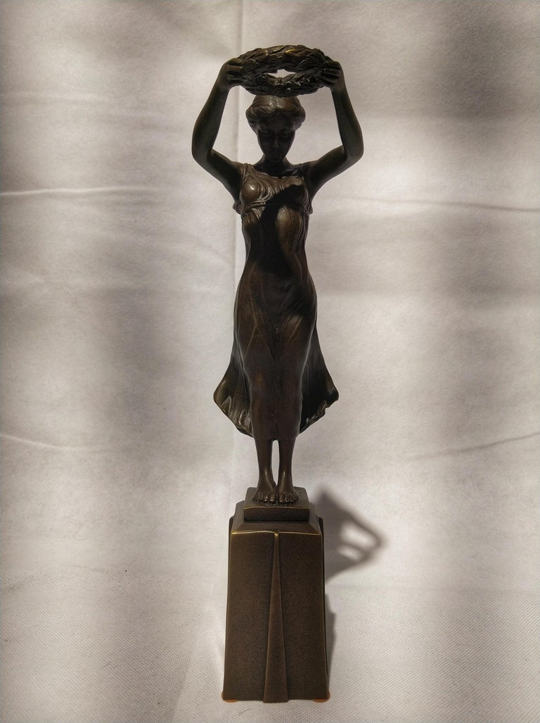 Beautiful Art Deco style sculpture, depicting the nimph Daphne with a laurel crown in his hands that it was given as a prize to the winners of the competitions.  Daphne a minor figure in Greek mythology, is a naiad, a variety of female nymph