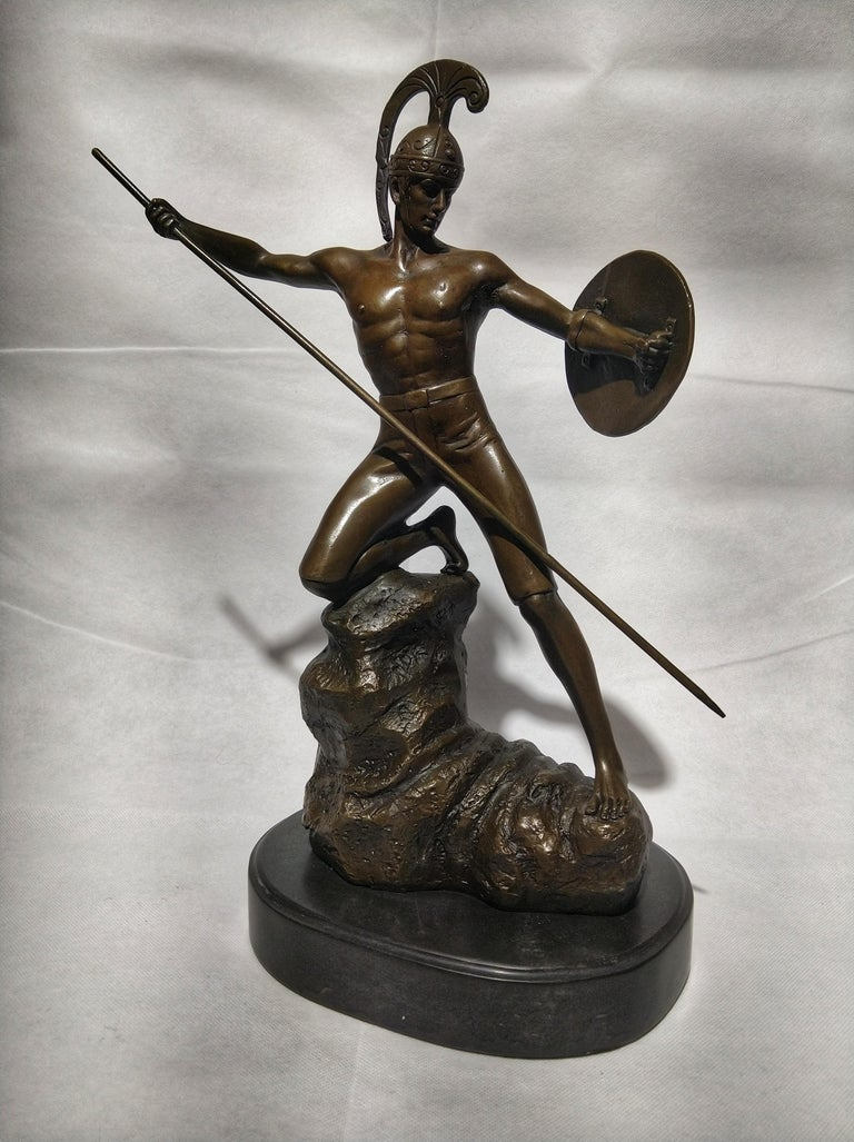 Beautiful Art Deco style sculpture, depicting Mars (God of war) or Achilles with spear and shield in attack pose. And is sitting on a black marble base and is signed D.M Jensen.  In ancient Roman religion and myth, Mars was the god of war and also