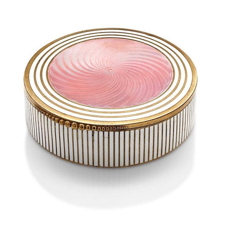 Vintage 20th century Art Deco silver circular pink and gold enamel powder box Diameter: 3.25