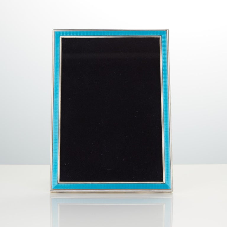 20th century Art Deco sterling silver and enamel photo frame by maker Maquet, France, circa 1925 this piece is beautifully made the cast silver frame and applied guilloche enamel are of the highest quality. Can be displayed in both horizontal and