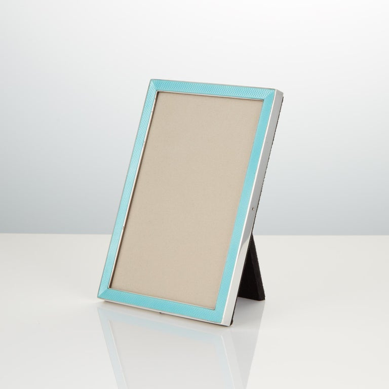 """This great quality cast silver & enamel frame is in excellent condition.  The enamel has a translucent quality and the silver is marked sterling.  The back & easel support is covered in black velvet.  Dimensions are H 7"""" W 4 3/4"""" depth of"""