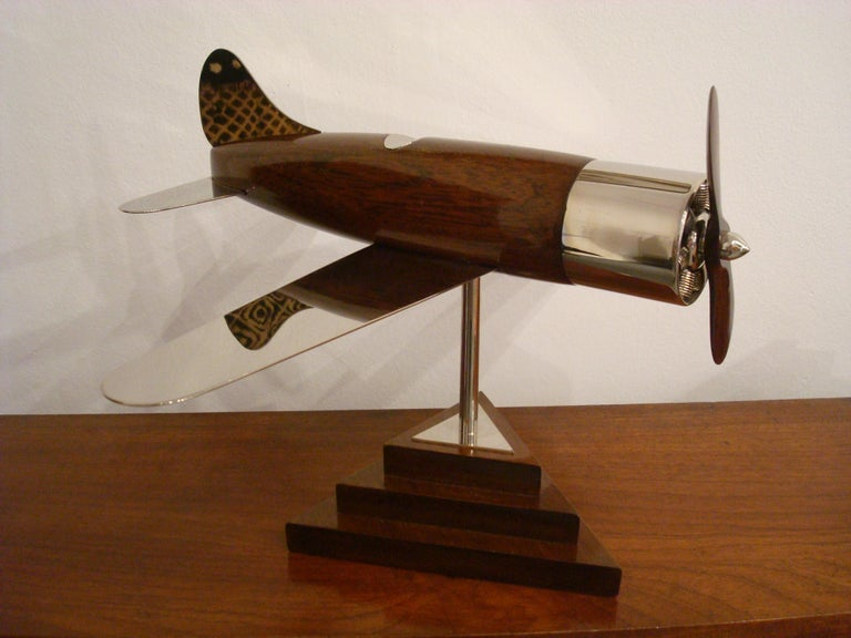 Very nice large 20th century, Art Deco streamline airplane wooden desk model sculpture. Perfect for any aviation fan. Made of wooden and silvered brass. Professional restoration has been made. Excellent conditions. Fantastic details in the engine.