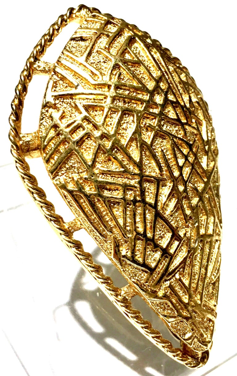 20th Century Art Deco Style Gold Plate Brooch & Necklace Pendant By, Coventry. Signed on the underside, Sarah Cov. This large scale gold Art Deco Style brooch features a dimensional and abstract pattern with a pendant necklace bale on the underside.
