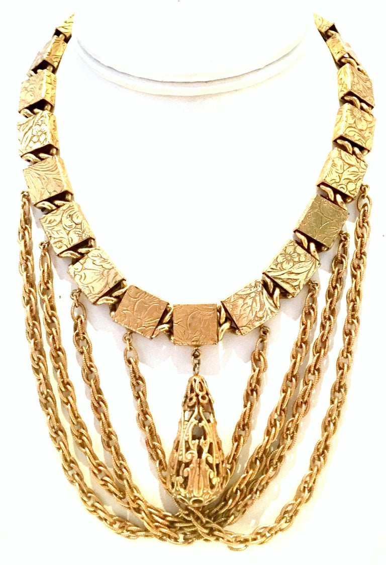 Mid-20th Century Art Nouveau Gold Plate Stamped Book Chain Swag Pendant Choker Style Necklace & Earrings, Set Of Three Pieces. This incredibly rare set features an Art Nouveau floral stamped motif with filigree teardrop ornament. The necklace