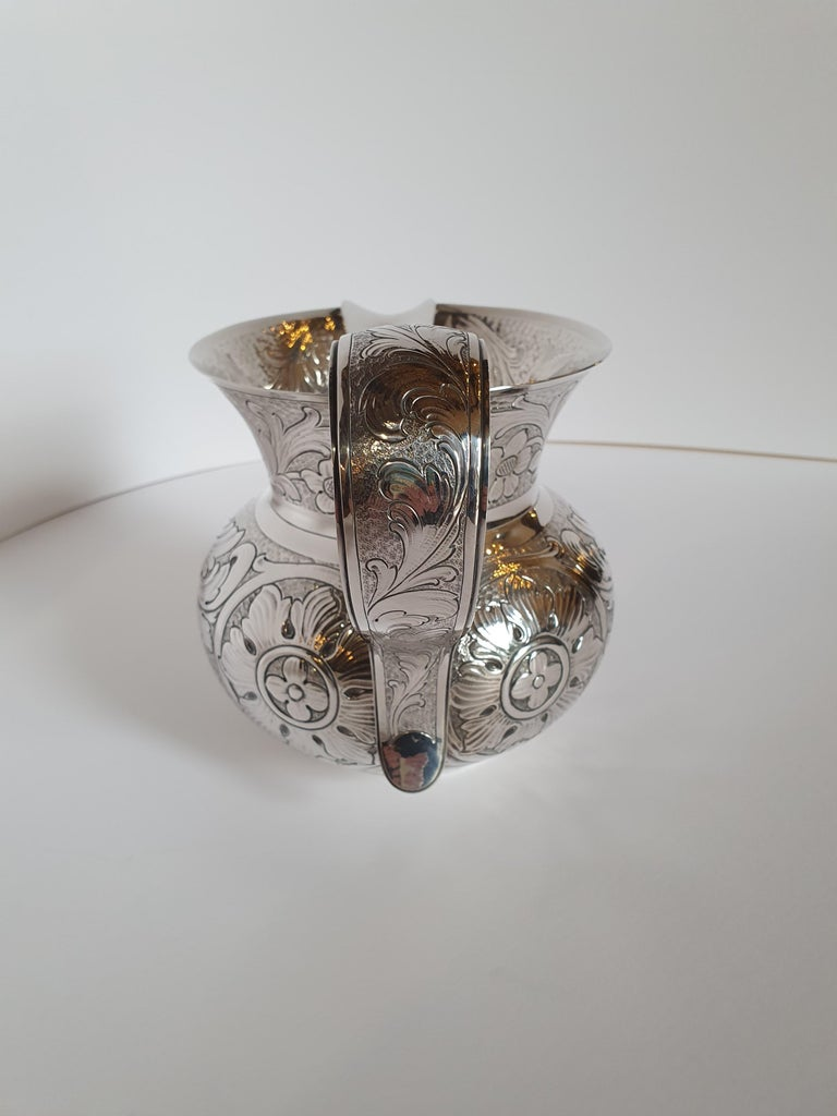 Magnificente handcrafted sterling silver water jug inspired by a piece in the collection of Museo Poldi Pezzoli in Milan. The incomparable chisel work reproduces the motif with leaves and flowers typical of 17th century. Pradella Ilario, founded