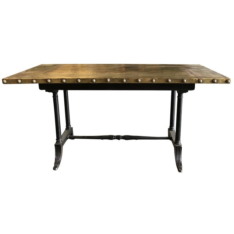 Early 20 century, a vintage Belgian Art Deco metal work table with hand crafted copper top and riveted border. Aged patina, with a strong industrial aesthetic. The four legs uniquely shaped providing stability to the work surface. Wear consistent