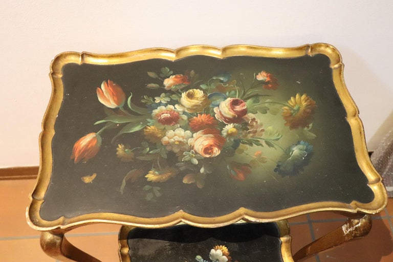 Rare and fine quality Italian Louis XV style, 1930s two side tables or sofa tables. The tables has a particular legs slender. Fine hand painted decoration with floral taste. Painting of great pictorial quality. The legs are golden with gold leaf.