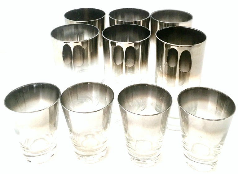 20th century blown glass and sterling silver drinks set by, Dorothy Thorpe, set of 10. Set includes, six high ball drink glasses and four cocktail glasses. Features a translucent base with sterling silver overlay edge. The cocktail glass measures: