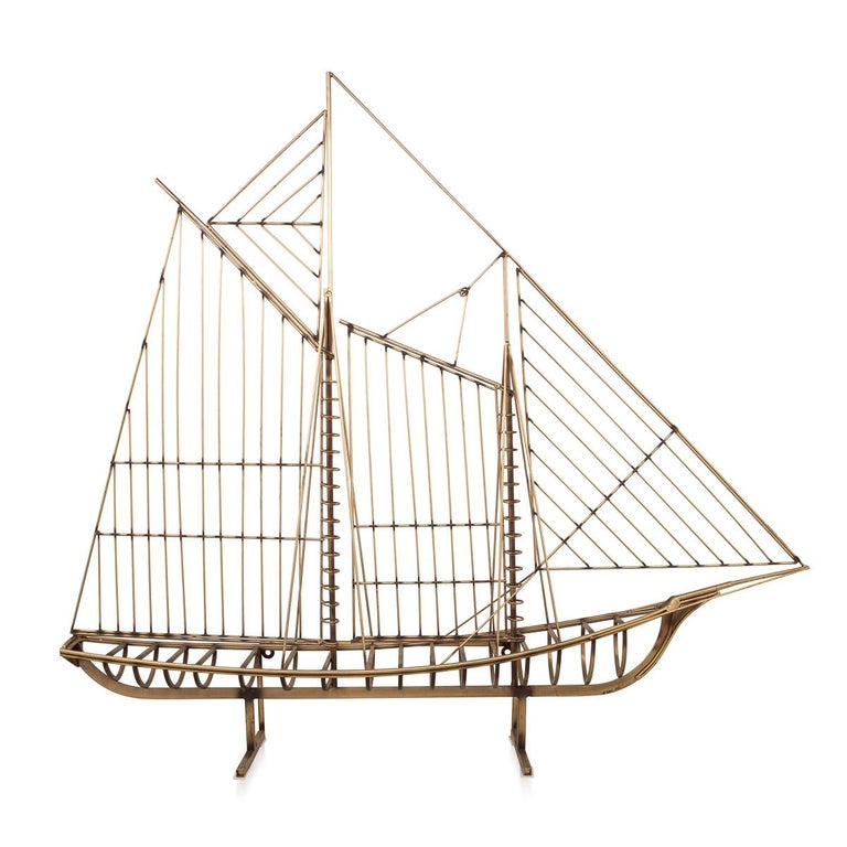 Stunning 20th century brass Galleon ship, this large geometric ship was created by Curtis Freiler & Jerry Fels. The name of the artist and furniture designer Curtis Jeré was, in fact, the shared pseudonym of two individual American artists, Curtis