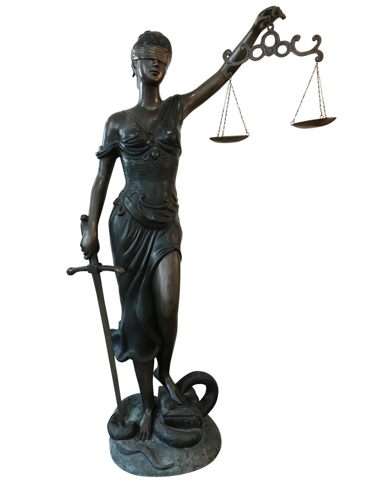 Beautiful quality lifesize bronze of the Roman Goddess Iusticia, or more recently named Lady Justice, depicted here wearing a blindfold to represent objectivity, holding scales to represent evidence, and a sword to represent punishment and standing