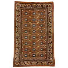 19th Century Brown and Blue Stylized Rosette Gul Chinese Khotan Rug, circa 1870s