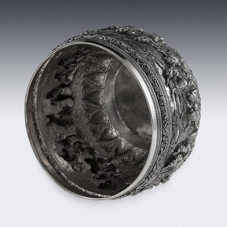 Antique early 20th century Burmese, Myanmar solid silver Thabeik bowl, repousse' decorated in high relief depicting different traditional scenes from the Burmese mythology, showing detailed figures set against a chiseled matted background in