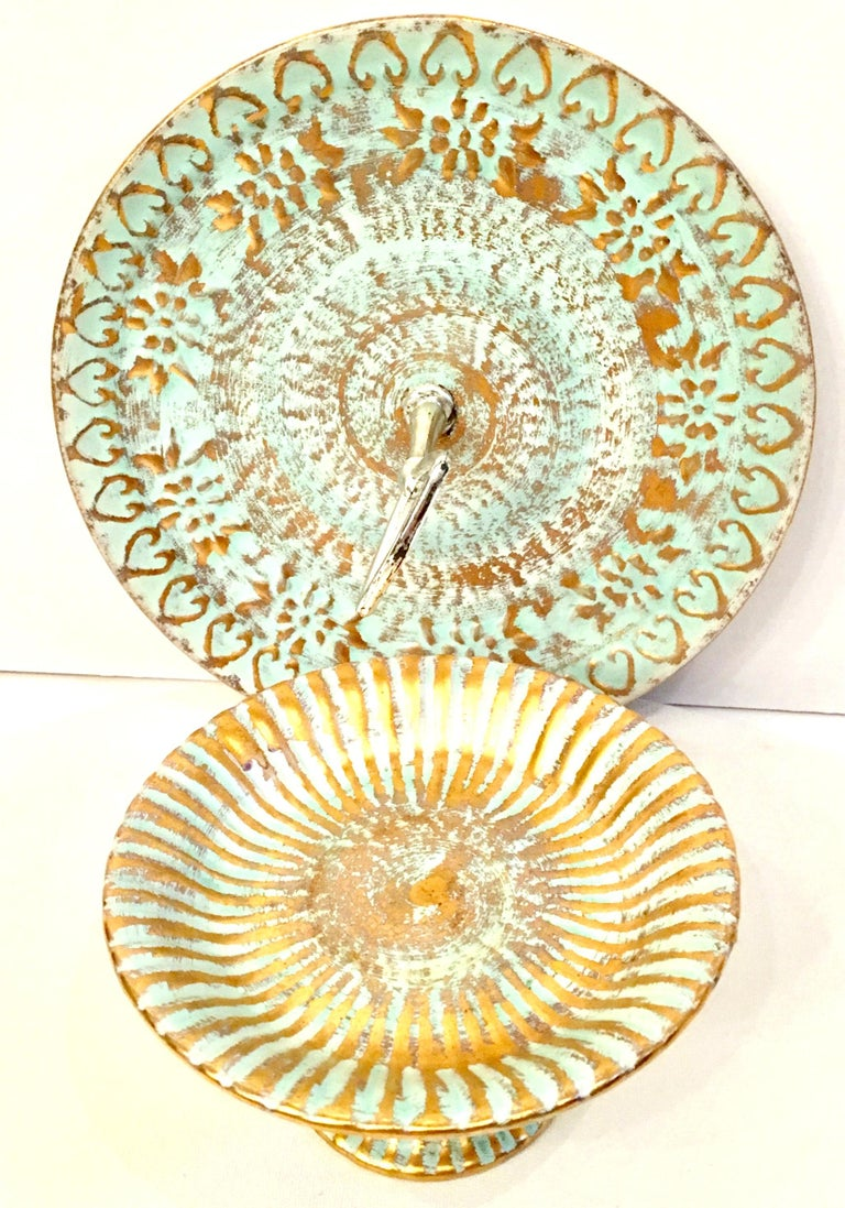 Mid-20th century set of two ceramic hand painted aqua and 22-karat gold serving pieces by Stangl Pottery. This two piece set includes a pedestal plate and chrome handled serving platter. Each pieces is signed on the underside, Stangl. The pedestal