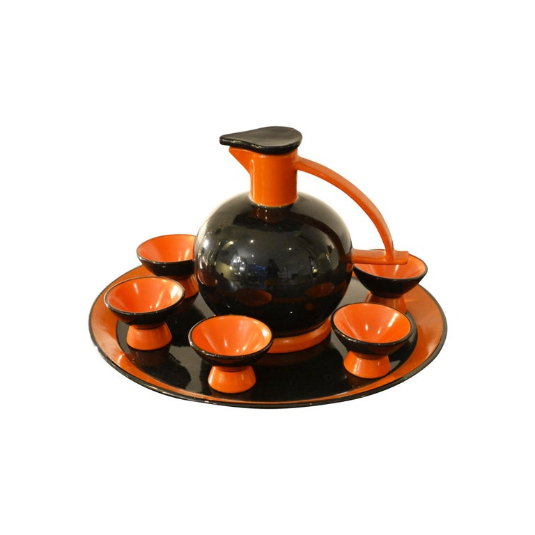 Rosolio set with carafe, plate and 6 cups in glazed ceramic by Ceramiche Rometti of Umbertide of the 1950s. Orange and Black coloured. Very good condition, signature under the carafe as shown in photo.
