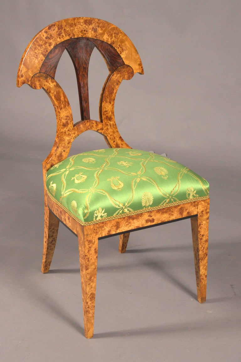 Solid beechwood with maple root veneer. Conical squares. Straight frame. Exceptional arched backrest. Connected by a curved middle bridge. Seat surface, classic padded. High-quality Empire satin fabric. This form is known in numerous literatures.