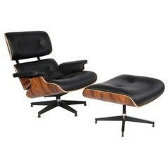 20th Century Charles and Ray Eames Set of Two Lounge Chair in Rosewood & Leather