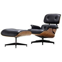 20th Century Charles & Ray Eames Black Leather Lounge Chair with Ottoman