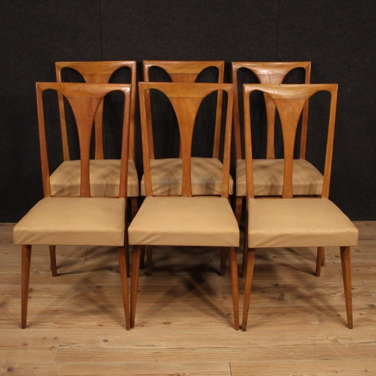 Group of Italian chairs from the 1960s and 1970s. Italian design cherrywood carved furniture of beautiful lines and pleasant decor. Chairs covered in faux leather with some signs of wear (see photo) with seat height of 48 cm. Ideal furniture to be