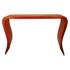 20th century Chinese console table in red lacquered wood.