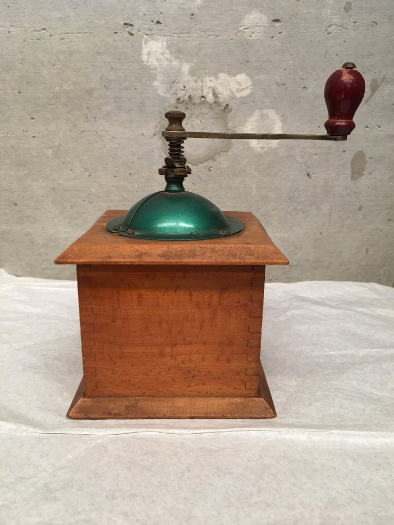 20th century coffee grinder with shaped top and treen handle.