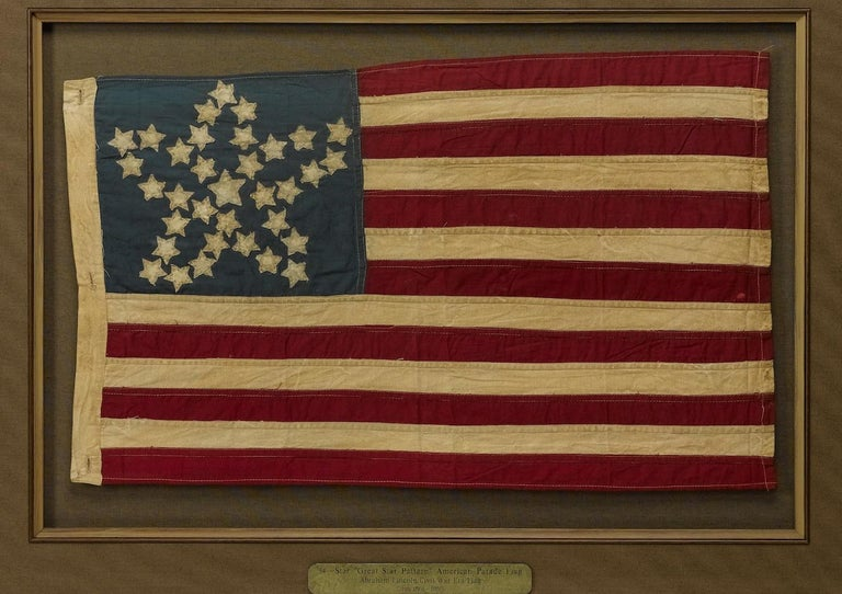 This is a 20th century commemorative flag with 34 stars in recognition of when Kansas was admitted into the Union. Kansas was admitted to the Union on January 29th, 1861, about two-and-a-half months before the first shots of the civil war were