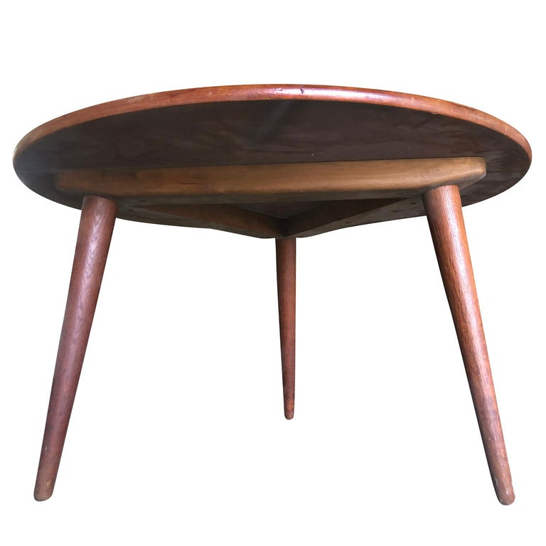 A vintage Mid-Century Modern round coffee table made of hand carved teak wood. The Danish side table was designed by Hans J. Wegner and produced by Andreas Tuck, in good condition. Wear consistent with age and use, circa 1950-1960, Denmark,