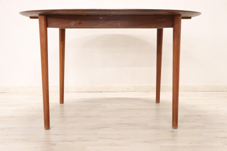 Refined teak design table by Peter Hvidt for Søborg 1950s. This table extends with an opening in the center. Support surfaces to be placed in the center are not included. Brand under the design manufacturing plan. Perfect dining table for a modern