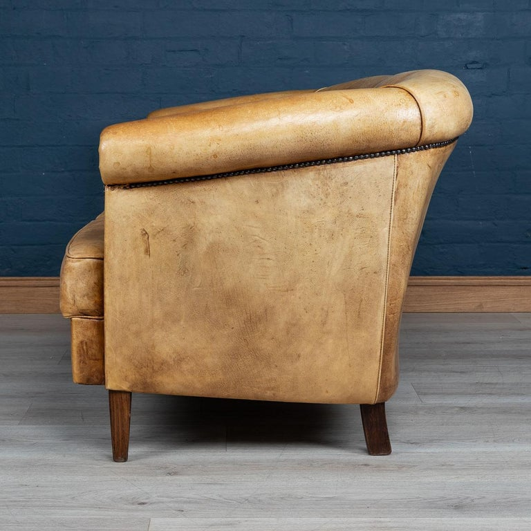 A wonderful leather two-seat sofa in rich tan leather, north European (probably Belgium or Holland), mid to late 20th century.