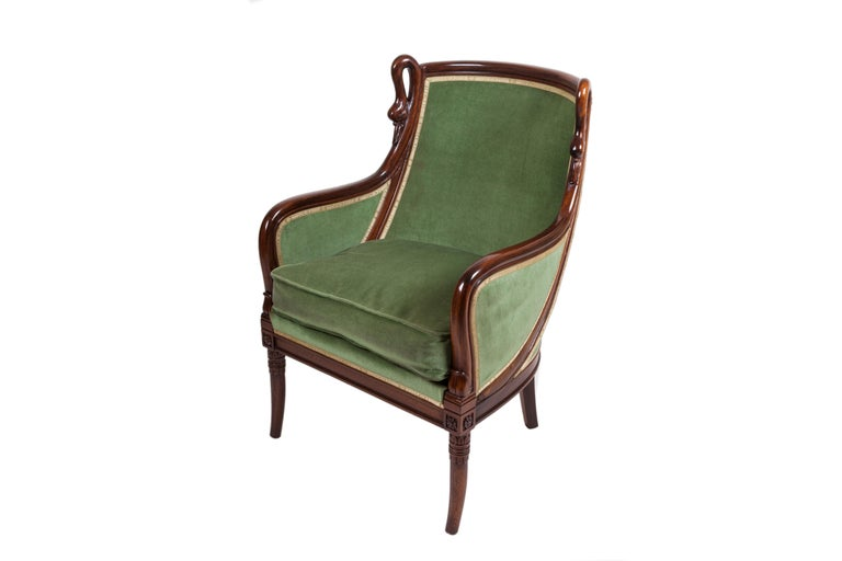 Pair of mahogany armchairs, very well designed, with swan-neck armrests. Restored and finished with shellac. Slight signs of wear.  Possibility to purchase another identical pair and to upholster with any color of velvet fabric. France, circa