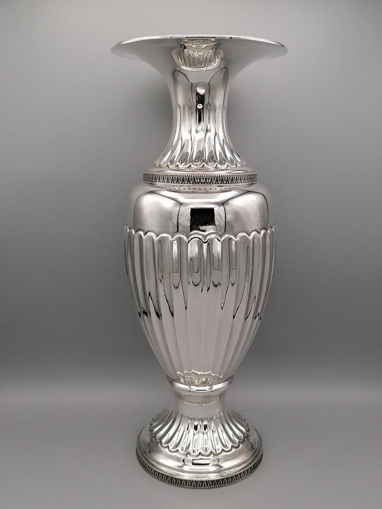Silver 800 vase Empire revival on foot.  The body and the foot are cheased and ambossed  Three leaves rims determine the typical Empire style 1,080 grams. By Arval Argenti Valenza .- Italy