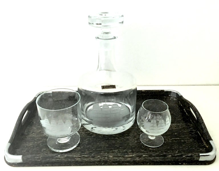 20th century Romanian etched hand blown glass and Cerused chrome wood tray, drinks set of 12. Set includes one American made Cerused wood cutout handle tray with silver chrome detail, one modern etched hand blown Romanian Nautical ship motif