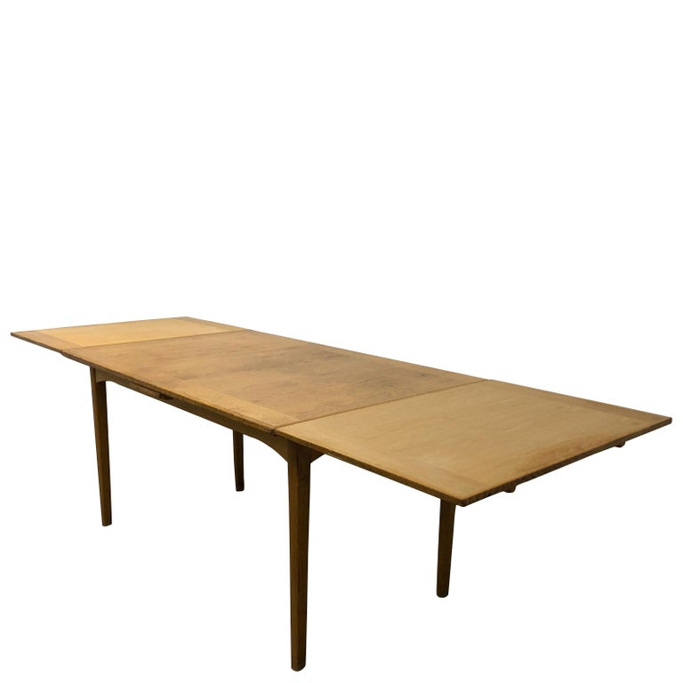 A Mid-Century Modern extension table made of walnut from Carl Malmsten. Model Gustavus.  Measures: Unextended 29.5 H x 55.5 W x 35.5 D Extended 29.5 H x 102.5 W x 35.5 D.  Carl Malmsten was born in 1888 Sweden and passed away in 1972. Malmsten