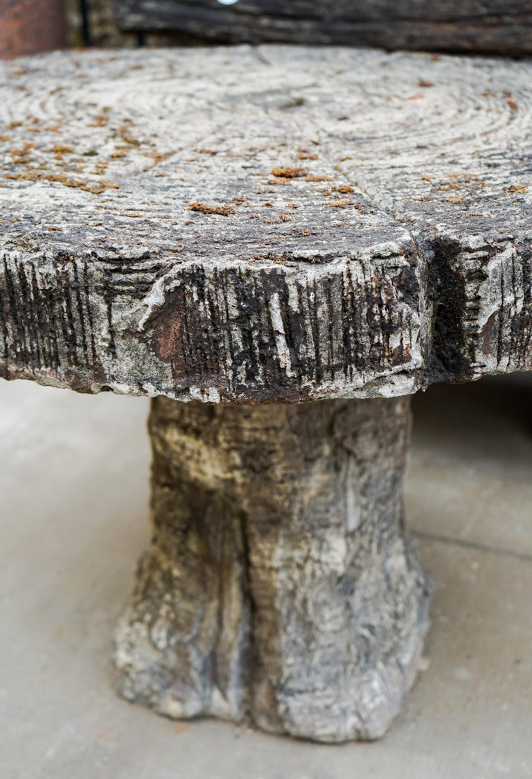 Early 20th century faux bois garden table and bench with natural patina and moss. Sits two comfortably. Bench and table come together as a set.